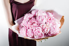 Fresh bright blooming peonies flowers with dew drops on petals. white and pink bud. kraft paper. crisp packaging Stock Image