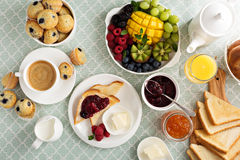 Fresh and bright continental breakfast table. With fruit plate Stock Images