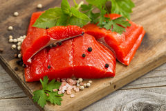 Fresh bright red Copper River Salmon fillets on rustic wooden se Stock Photos