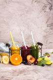 Fresh bright smoothies in a wire basket Stock Photography