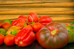 Fresh bright tomato with leaves on the wood background Stock Images