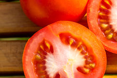 Fresh, bright tomato in slices. Slices tomatos on cutting board Stock Photography
