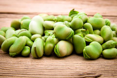 Fresh broad bean on old wooden Royalty Free Stock Photo