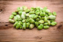 Fresh broad bean on old wooden Stock Photo