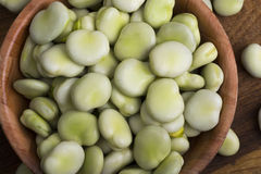 Fresh broad beans in bowl. On wooden board Royalty Free Stock Photography