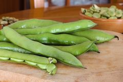 Fresh broad beans fava on wood table Royalty Free Stock Images