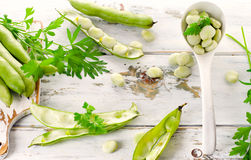 Fresh broad beans over  wooden background. Stock Photography
