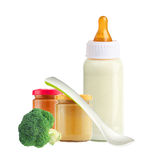 Fresh broccoli, baby food, spoon and and milk bottle isolated Stock Photo