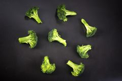 Fresh broccoli with a black background royalty free stock photos