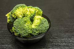 Fresh broccoli in a bowl. Fresh broccoli in a bowl on a dark background Royalty Free Stock Photography