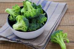 Fresh broccoli in a bowl on a rustic table Stock Photography