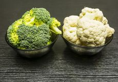 Fresh broccoli and cauliflower in a bowl. Stock Photos