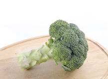 Fresh broccoli in closeup. Fresh broccoli on chopping block Stock Images