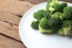 Fresh broccoli cut vegetable in white plate healthy natural clean food Stock Images