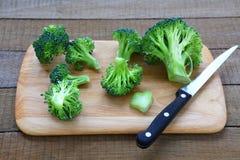 Fresh broccoli on cutting board Stock Image