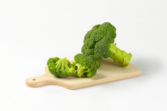 Fresh broccoli on cutting board Stock Photos