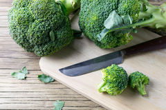 Fresh broccoli on a cutting board and knife. Closeup Royalty Free Stock Image