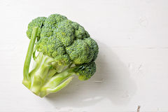 Fresh broccoli on cutting board vegetarian cooking. Royalty Free Stock Photos