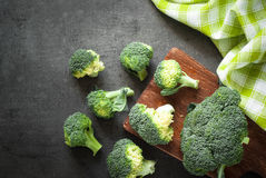 Fresh broccoli at dark table. Royalty Free Stock Photo