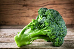 Fresh broccoli on a dark wooden background, top view.  Royalty Free Stock Image