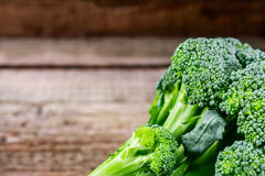 Fresh broccoli on a dark wooden background, top view.  Royalty Free Stock Images