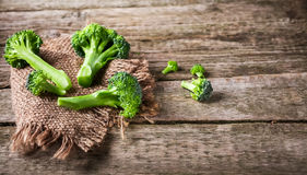 Fresh broccoli on a dark wooden background, top view.  Royalty Free Stock Photography