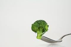 Fresh broccoli on fork Stock Photos
