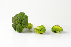 Fresh broccoli head and pieces Royalty Free Stock Photo
