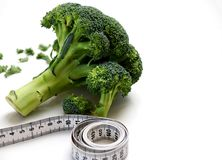 Fresh broccoli and measuring tape stock photo