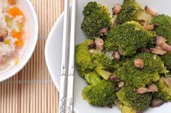 Fresh broccoli and mushroom delicacy Stock Photos