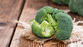 Fresh Broccoli. Fresh raw Broccoli as detailed close-up shot on wooden background Royalty Free Stock Photography