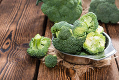 Fresh Broccoli. Fresh raw Broccoli as detailed close-up shot on wooden background Stock Photo