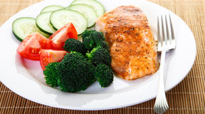 Fresh Broccoli and Ripe Tomatoes with Salmon Stock Photo