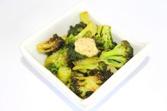 Fresh broccoli with spicy butter Royalty Free Stock Photo