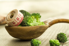 Fresh broccoli in a spoon on wooden background. healthy food, vegetarian, slimming Stock Photography