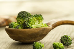 Fresh broccoli in a spoon on wooden background. healthy food, vegetarian, slimming Stock Images