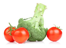 Fresh Broccoli and three red juicy tomato Isolated Royalty Free Stock Photo