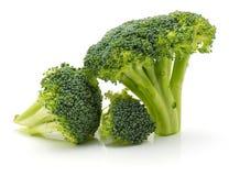 Broccoli on white. Fresh broccoli on white background three pieces stock image