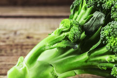 Fresh broccoli on a wooden background Stock Photos