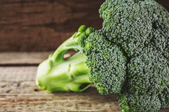 Fresh broccoli on a wooden background Royalty Free Stock Photos