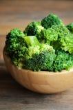 Fresh broccoli on wooden background Stock Image