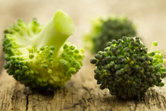 Fresh broccoli on wooden background. healthy food, vegetarian, slimming Royalty Free Stock Photo