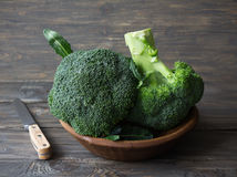 Fresh broccoli in a wooden bowl on wooden table Stock Photo