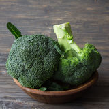 Fresh broccoli in a wooden bowl on wooden table Stock Image