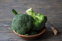 Fresh broccoli in a wooden bowl on wooden table Royalty Free Stock Photo