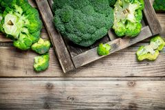 Fresh broccoli in a wooden box. On a wooden background stock photos