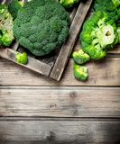 Fresh broccoli in a wooden box. On a wooden background stock images