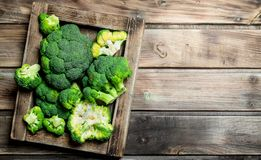 Fresh broccoli in a wooden box. On a wooden background royalty free stock image