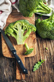 Fresh broccoli on wooden cooking board Stock Photo