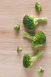 Fresh broccoli on the wooden cutting board. Top view Stock Images